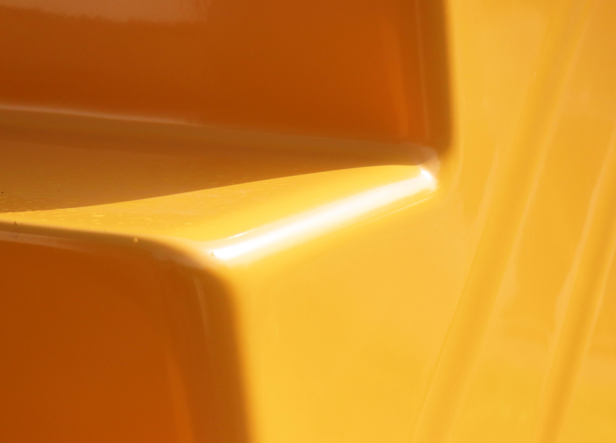 Close-up of yellow pool stair