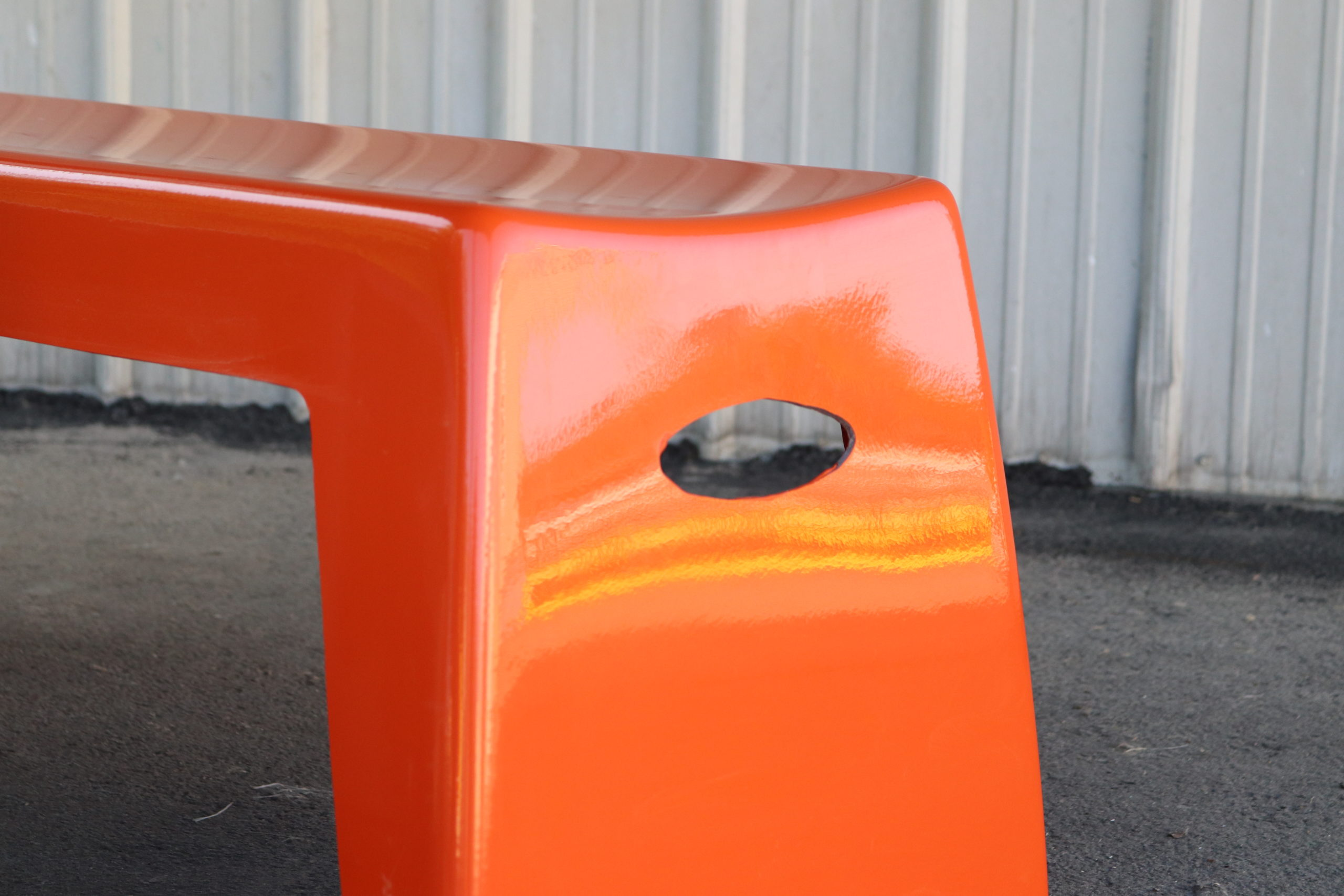 Closeup view of Orange Bench Handle