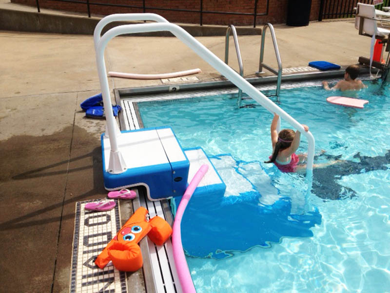 ADA Easy Stair in use in commercial pool